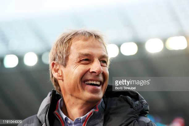 Jurgen Klinsmann, Manager of Hertha BSC looks on prior to the Bundesliga match between Hertha BSC and Borussia Dortmund at Olympiastadion on November...