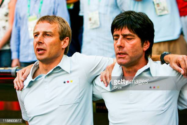 Jurgen KLINSMANN of Germany and Joachim LOW of Germany during the world cup match between Allemagne and Sweden in Allianz Arena, Munchen, on 24th...