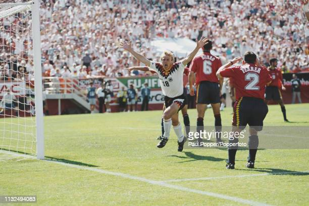 Jurgen Klinsmann of Germany celebrates after scoring an equalising goal during play between Germany and Spain in their 1994 FIFA World Cup Group C...