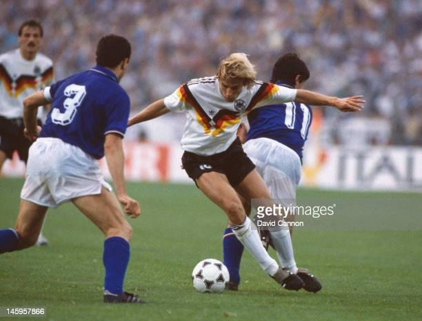 Jurgen Klinsmann of West Germany shields the ball from Giuseppe Bergomi and Fernando De Napoli of Italy during the UEFA European Championships 1988...