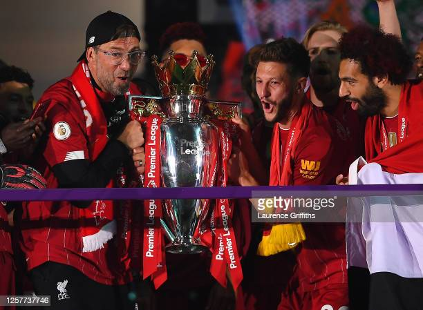 Jurgen Klopp, Adam Lallana and Mohamed Salah of Liverpool holds the Premier League Trophy celebrate winning the League Title during the presentation...