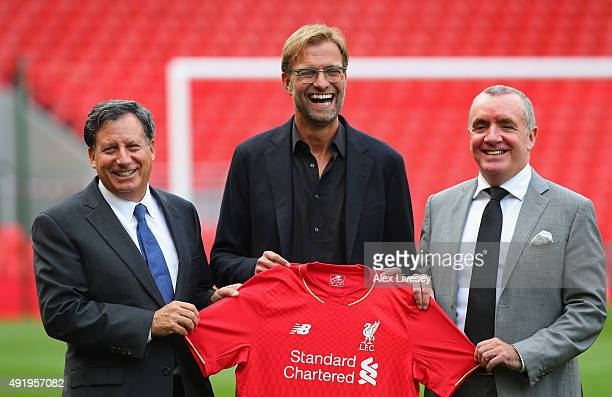 Jurgen Klopp at Anfield is unveiled as the new manager of Liverpool FC as he stands alongside Tom Werner the chairman and Ian Ayre the chief...