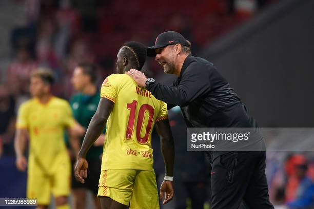 Jurgen Klopp head coach of Liverpool gives instructions to Sadio Mane of Liverpool during the UEFA Champions League group B match between Atletico...
