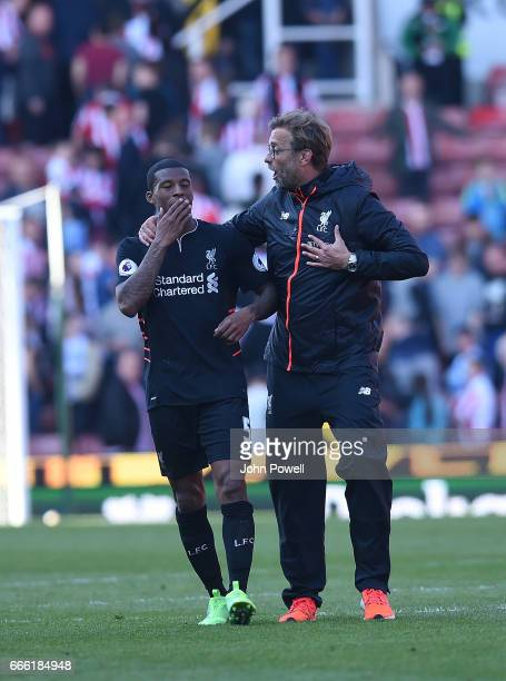 Jurgen Klopp Manager and Georginio Wijnaldum of Liverpool at the end of the Premier League match between Stoke City and Liverpool at Bet365 Stadium...