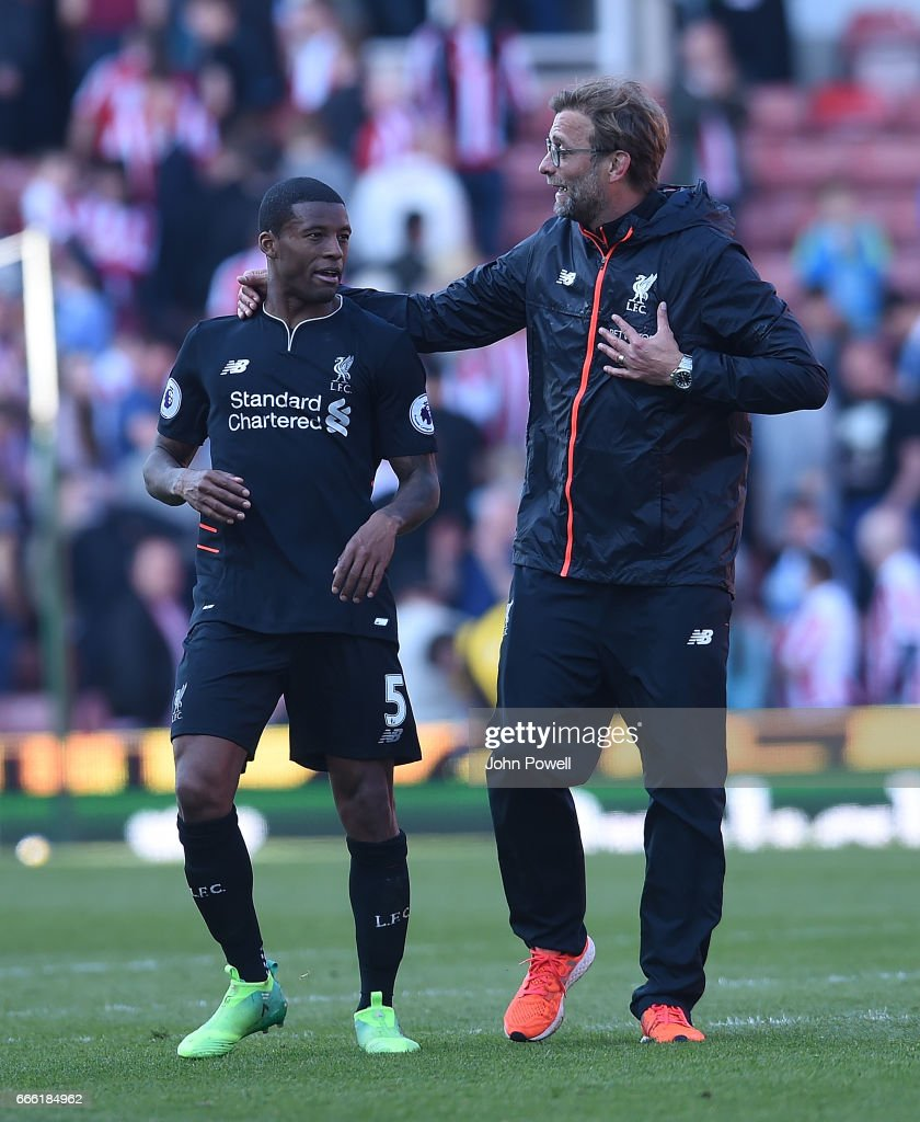 Jurgen Klopp Manager and Georginio Wijnaldum of Liverpool at the end of the Premier League match between Stoke City and Liverpool at Bet365 Stadium on April 8, 2017 in Stoke on Trent, England.