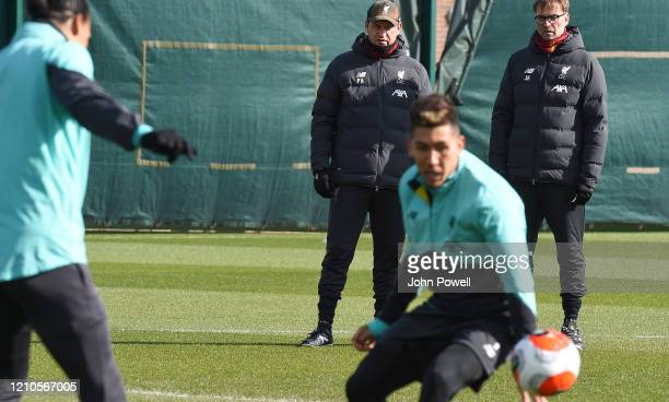 Jurgen Klopp manager and Peter Krawietz of Liverpool during a training session at Melwood Training Ground on March 05 2020 in Liverpool England