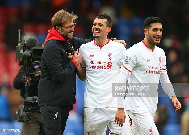 Jurgen Klopp manager celebrates with Dejan Lovren and Emre Can of Liverpool after the Barclays Premier League match between Crystal Palace and...