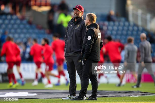 Jurgen Klopp manager / head coach of Liverpool and Christophe Buhler assistant head coach of Huddersfield Town prior to the Premier League match...