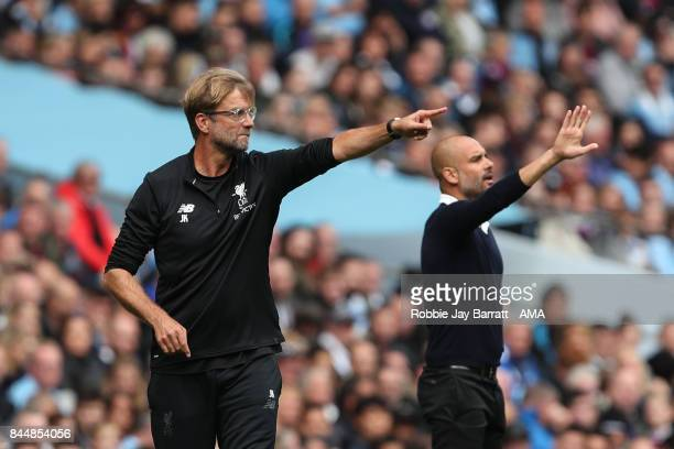 Jurgen Klopp manager / head coach of Liverpool and Pep Guardiola the head coach / manager of Manchester City during the Premier League match between...