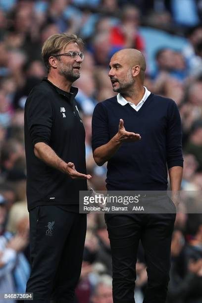 Jurgen Klopp manager / head coach of Liverpool and Pep Guardiola the head coach / manager of Manchester City discuss during the Premier League match...