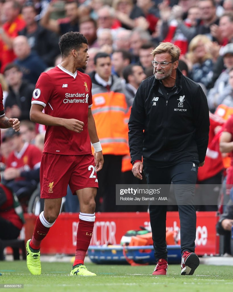 Jurgen Klopp manager / head coach of Liverpool celebrates with Dominic Solanke of Liverpool after Sadio Mane of Liverpool scores a goal to make it 1-0 during the Premier League match between Liverpool and Crystal Palace at Anfield on August 19, 2017 in Liverpool, England.