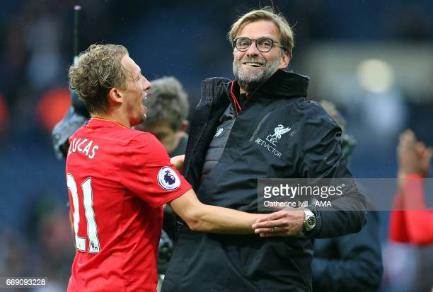 Jurgen Klopp manager / head coach of Liverpool celebrates with Lucas Leiva of Liverpool after the Premier League match between West Bromwich Albion...