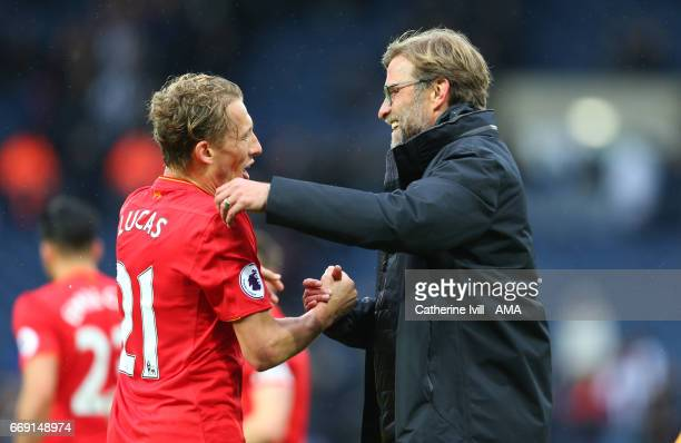 Jurgen Klopp manager / head coach of Liverpool celebrates with Lucas Leiva of Liverpool during the Premier League match between West Bromwich Albion...