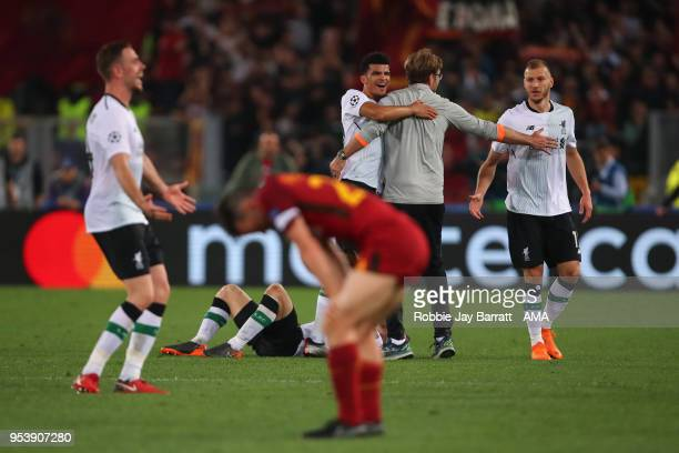 Jurgen Klopp manager / head coach of Liverpool celebrates with Ragner Klavan of Liverpool at full time during the UEFA Champions League Semi Final...