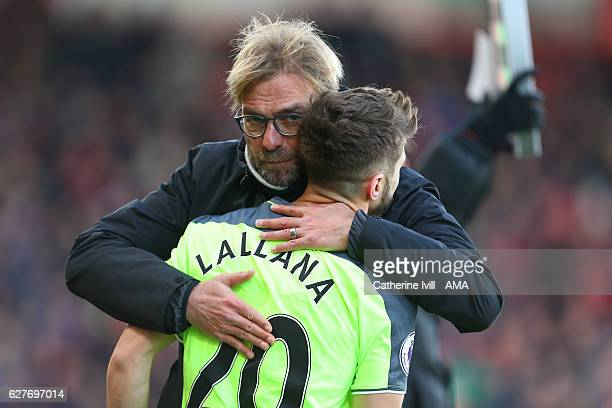 Jurgen Klopp manager / head coach of Liverpool hugs Adam Lallana of Liverpool during the Premier League match between AFC Bournemouth and Liverpool...
