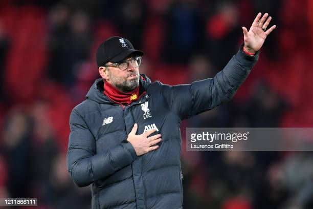 Jurgen Klopp Manager of Liverpool acknowledges the fans after the UEFA Champions League round of 16 second leg match between Liverpool FC and...