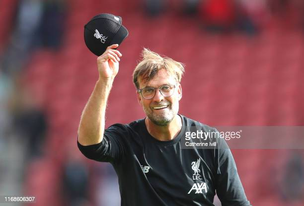 Jurgen Klopp Manager of Liverpool acknowledges the fans following his teams victory in the Premier League match between Southampton FC and Liverpool...