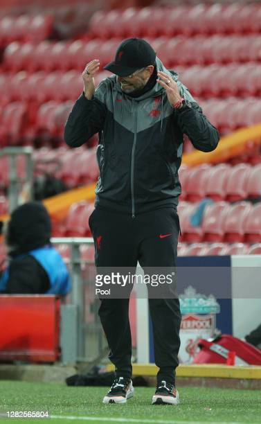 Jurgen Klopp Manager of Liverpool adjusts his face covering during the UEFA Champions League Group D stage match between Liverpool FC and FC...