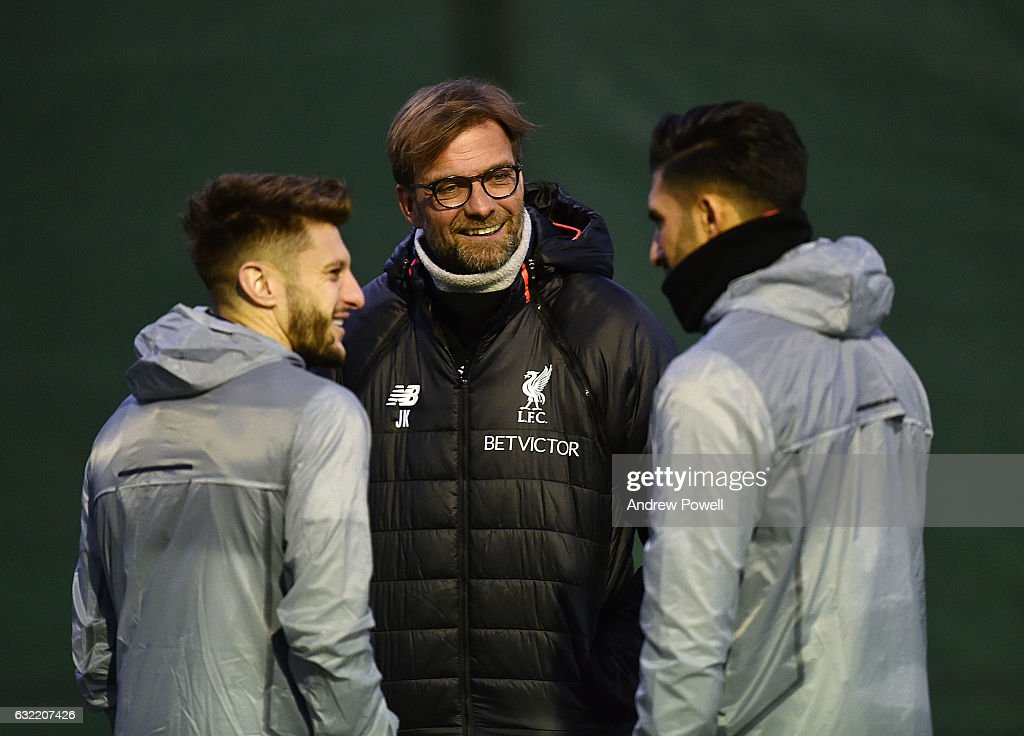 Jurgen Klopp manager of Liverpool and Adam Lallana and Emre Can during a training session at Melwood Training Ground on January 20, 2017 in Liverpool, England.