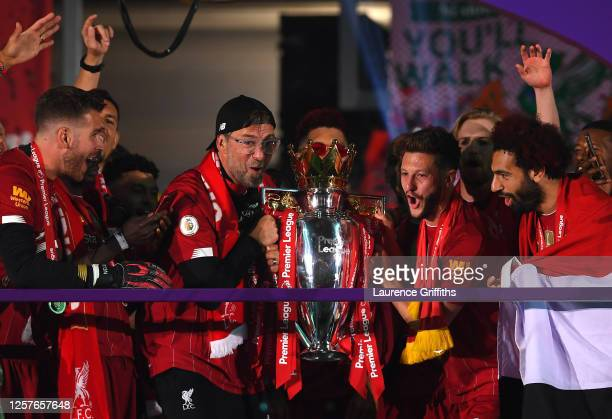 Jurgen Klopp, Manager of Liverpool and Adam Lallana of Liverpool lift The Premier League trophy following the Premier League match between Liverpool...