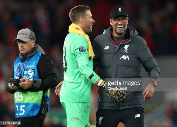 Jurgen Klopp Manager of Liverpool and Adrian of Liverpool celebrate during the UEFA Champions League group E match between Liverpool FC and RB...