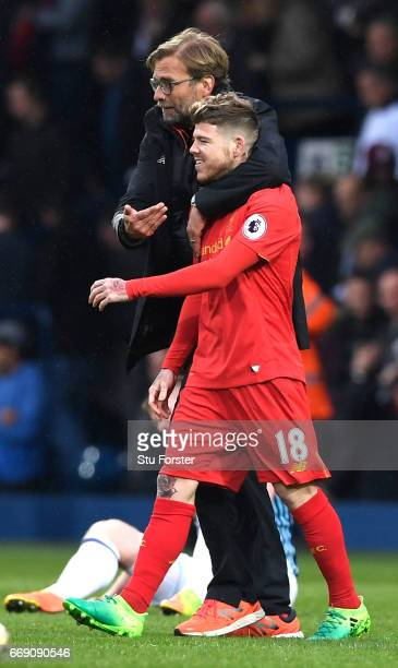 Jurgen Klopp Manager of Liverpool and Alberto Moreno of Liverpool embrace after the Premier League match between West Bromwich Albion and Liverpool...