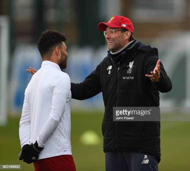 Jurgen Klopp manager of Liverpool and Alex OxladeChamberlain of Liverpool during the training session at Melwood Training Ground on March 15 2018 in...