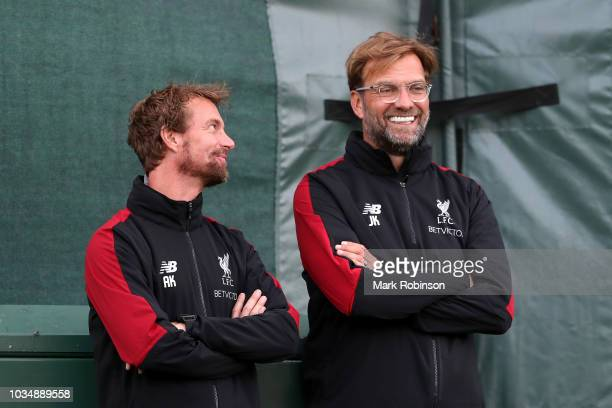 Jurgen Klopp Manager of Liverpool and Andreas Kornmayer Head of Fitness and Conditioning look on during a Liverpool training session at Melwood...