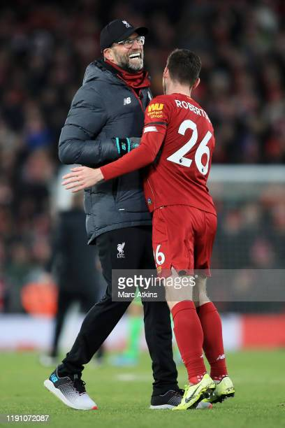 Jurgen Klopp, Manager of Liverpool and Andy Robertson of Liverpool celebrate win after the Premier League match between Liverpool FC and Brighton &...