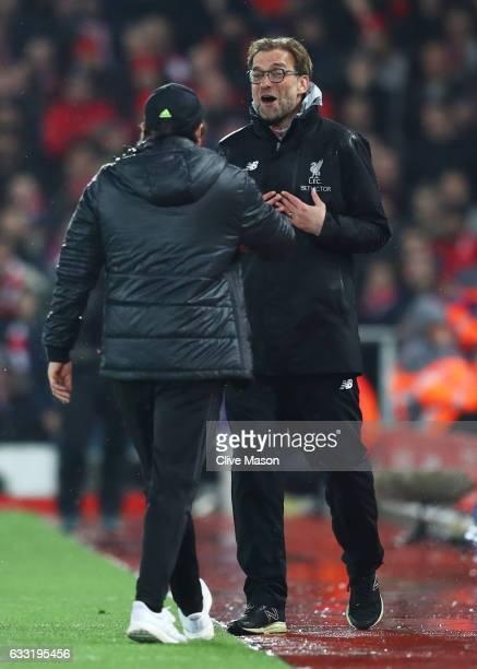 Jurgen Klopp Manager of Liverpool and Antonio Conte Manager of Chelsea talk during the Premier League match between Liverpool and Chelsea at Anfield...