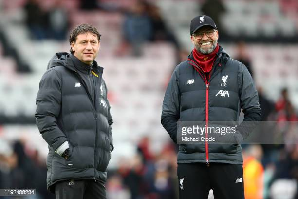 Jurgen Klopp Manager of Liverpool and assistant coach Peter Krawietz look on as his team warm up prior to the Premier League match between AFC...