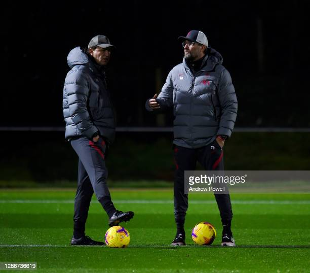 Jurgen Klopp manager of Liverpool and assistant manager Peter Krawietz during a training session at AXA Training Centre on November 20, 2020 in...