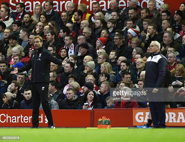 Jurgen Klopp manager of Liverpool and Claudio Ranieri manager of Leicester City react during the Barclays Premier League match between Liverpool and...