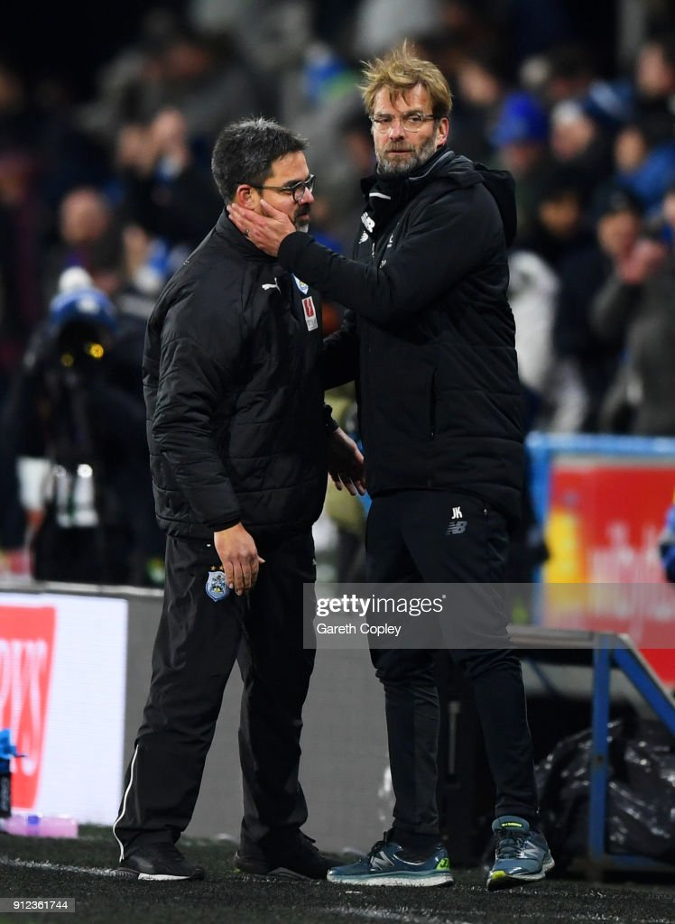 Jurgen Klopp, Manager of Liverpool (R) and David Wagner, Manager of Huddersfield Town embrace after the Premier League match between Huddersfield Town and Liverpool at John Smith's Stadium on January 30, 2018 in Huddersfield, England.