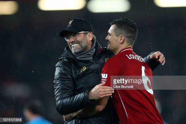 Jurgen Klopp Manager of Liverpool and Dejan Lovren of Liverpool celebrate following their sides victory in the Premier League match between Liverpool...