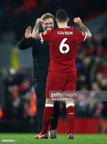 Jurgen Klopp Manager of Liverpool and Dejan Lovren of Liverpool celebrate together after the Premier League match between Liverpool and Leicester...