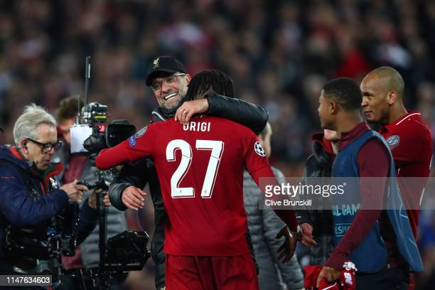 Jurgen Klopp Manager of Liverpool and Divock Origi celebrate after the UEFA Champions League Semi Final second leg match between Liverpool and...