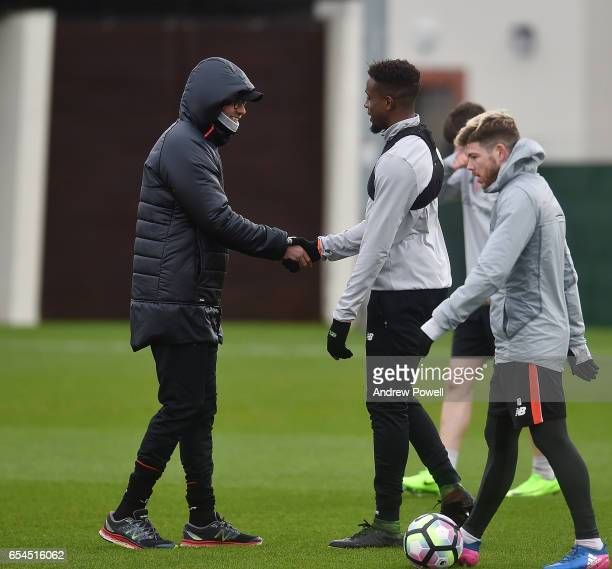 Jurgen Klopp manager of Liverpool and Divock Origi during a training session at Melwood Training Ground on March 17 2017 in Liverpool England