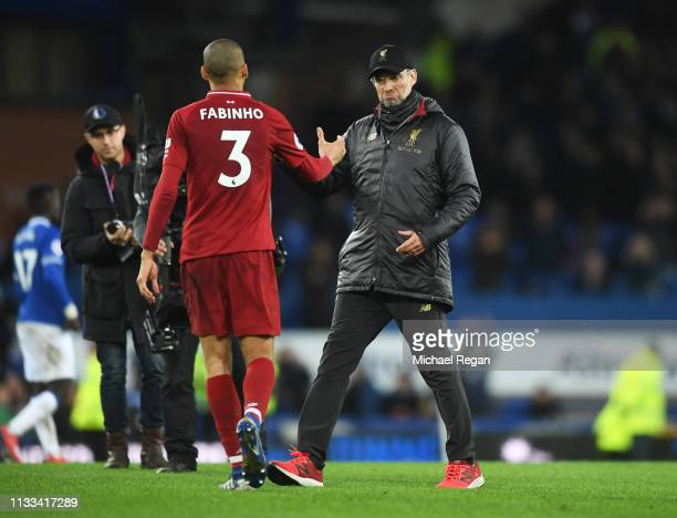 Jurgen Klopp Manager of Liverpool and Fabinho shake hands after the Premier League match between Everton FC and Liverpool FC at Goodison Park on...