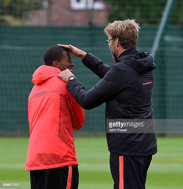Jurgen Klopp manager of Liverpool and Georginio Wijnaldum joke around during a training session at Melwood Training Ground on August 12 2016 in...