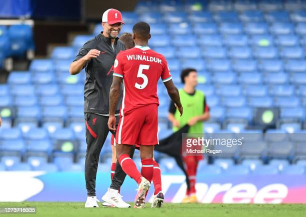 Jurgen Klopp Manager of Liverpool and Georginio Wijnaldum of Liverpool celebrate following their team's victory in the Premier League match between...