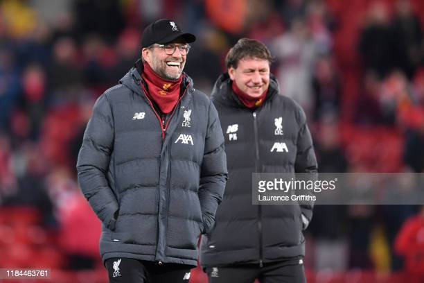 Jurgen Klopp Manager of Liverpool and his assistant Peter Krawietz share a joke on the pitch prior to the Carabao Cup Round of 16 match between...