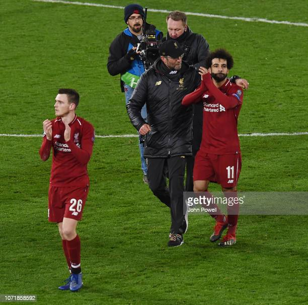 Jurgen Klopp Manager of Liverpool and his player Mohamed Salah talk at the end of the UEFA Champions League Group C match between Liverpool and SSC...