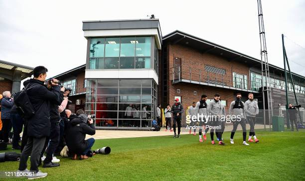 Jurgen Klopp manager of Liverpool and Joe Gomez Andy Robertson Trent AlexanderArnold and Jordan Henderson captain of Liverpool during a training...