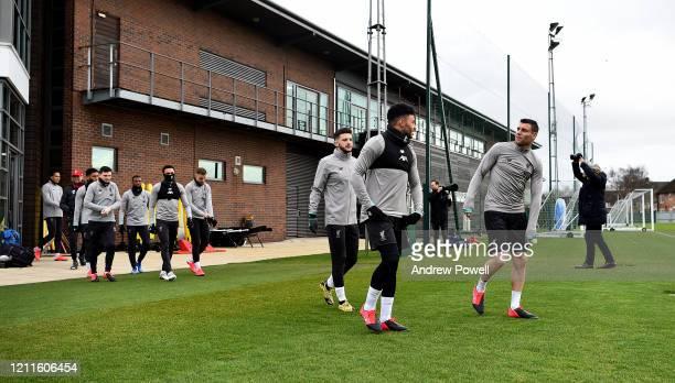 Jurgen Klopp manager of Liverpool and Joe Gomez Andy Robertson Trent AlexanderArnold and Jordan Henderson Adam Lallana Alex OxladeChamberlain and...