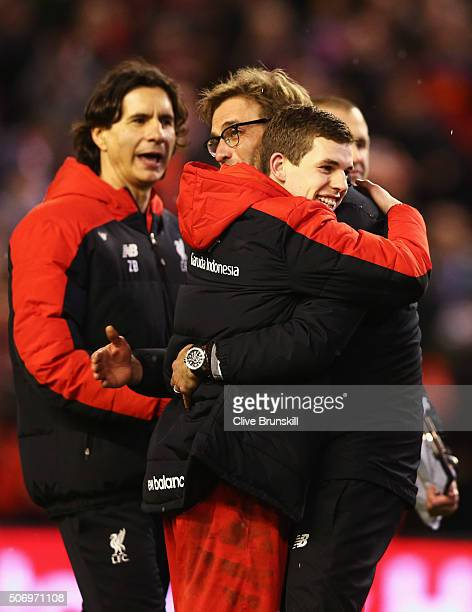 Jurgen Klopp manager of Liverpool and Jon Flanagan of Liverpool celebrate victory in the penalty shoot out after the Capital One Cup semi final...