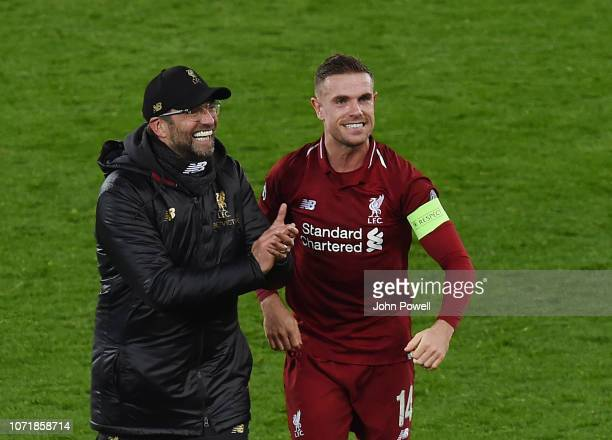 Jurgen Klopp Manager of Liverpool And Jordan Henderson at the end of the UEFA Champions League Group C match between Liverpool and SSC Napoli at...