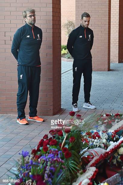 Jurgen Klopp manager of Liverpool and Jordan Henderson captain of Liverpool lay a wreath to pay tribute to victims of the Hillsborough disaster at...