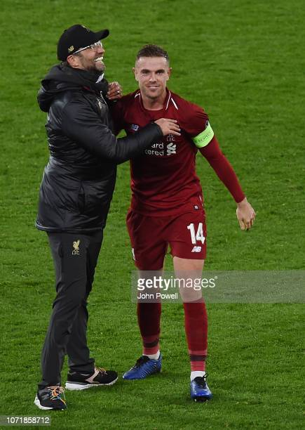 Jurgen Klopp Manager of Liverpool and Jordan Henderson celebrate at the end of the UEFA Champions League Group C match between Liverpool and SSC...