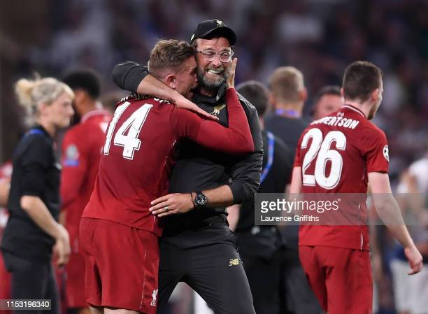 Jurgen Klopp Manager of Liverpool and Jordan Henderson celebrate victory after the UEFA Champions League Final between Tottenham Hotspur and...